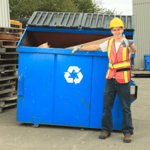 Big recycling bin and man